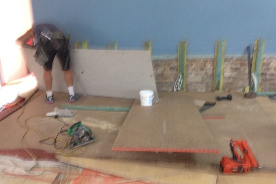 Laying Flooring in New Stage Area at West Ryde Family Church-The Right Builder